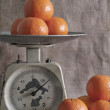 Tangerines on scales — Stock Photo #18806253
