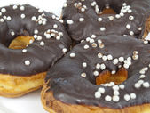 Doughnuts are in a chocolate — Stock Photo