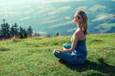 Young woman meditating outdoors — Stock Photo