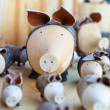 Cute wooden pigs — Stock Photo #12657362