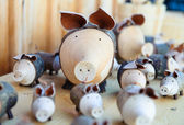 Cute wooden pigs — Stock Photo