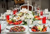 Luxury banquet table setting at restaurant — Stok fotoğraf