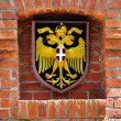 Coat of arms of Austria over brick wall - Stock Photo