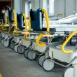 Row of empty beds in hospital corridor - Stock Photo