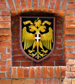 Coat of arms of Austria over brick wall — Stock fotografie