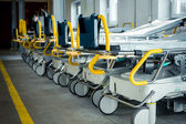 Row of empty beds in hospital corridor — Stockfoto