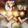 Two beautiful athletic girl jumping — Stock Photo