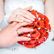 Stock Photo: Hands of the bride and groom and bridal bouquet close-up
