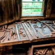 Farrier tools in ancient smithy - Stock Photo