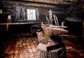 Farrier tools in ancient smithy — Stock Photo