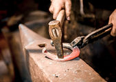 Blacksmith make a horseshoe — Stock Photo