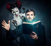 Priest evicting demons — Stock Photo