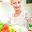 Young woman in the kitchen. — Stock Photo