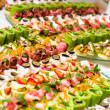 Trays with various delicious appetizer — Stock Photo
