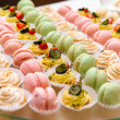 Stok fotoğraf: Tray with delicious cakes and macaroon