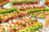Trays with various delicious appetizer — Stockfoto