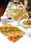 Table with various delicious appetizer — Stock Photo