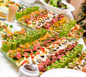 Trays with various delicious appetizer — Photo