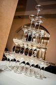 Champagne glass pyramid — Stock Photo