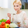 Young woman tasting soup. — Stock Photo