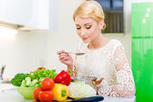 Young woman tasting soup.Healthy Food. Dieting Concept — Stock Photo