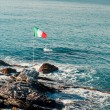 Italian flag and Ligurian Sea — Stock Photo
