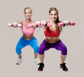 Women doing fitness exercise with dumbbells — Stock Photo