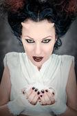 Portrait of devil woman holding heap of a white powder — Stock Photo