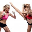 Two attractive athletic girls fighting — Stock Photo
