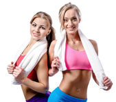 Two beautiful girls after workout with towels — Stock Photo
