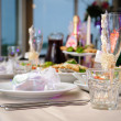 Luxury banquet table setting in restaurant close-up — Stock Photo