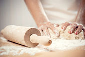 Woman kneading dough, close-up photo — Stock Photo