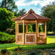 Outdoor wooden gazebo over summer landscape background — Stock Photo