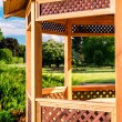 Stock Photo: Outdoor wooden gazebo over summer landscape background
