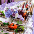 Stock Photo: Wedding table decorations with food and beverages
