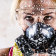 Portrait of a woman with protective filter mask — Stock Photo