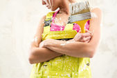 Female in coverall holding paint brush over obsolete white wall — Stock Photo