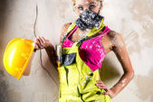 Female worker in respirator — Stock Photo