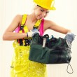 Female construction worker with tool bag indoors — Stock Photo