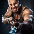 Muscular man pulling the chain — Stock Photo #28074635