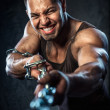 Stock Photo: Muscular man pulling the chain