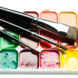 Watercolor paintbox and paintbrushes close-up — Stock Photo