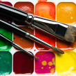Watercolor paintbox and paintbrushes close-up — Stock Photo #28074891