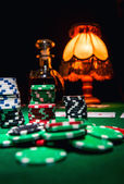 Gamble background, poker chips, cards and bottle of cognac — Stock Photo