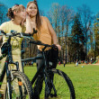 Pretty girls outdoors, summer leisure and cycling concept — Stock Photo