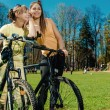 Stock Photo: Pretty girls outdoors, summer leisure and cycling concept
