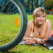 Stock Photo: Pretty girl outdoors, summer leisure and cycling concept
