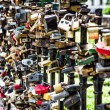 Love padlocks affixed to a bridge — Stock Photo #29226531
