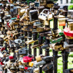 Love padlocks affixed to a bridge — Stock Photo