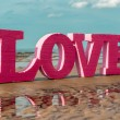 The word LOVE on the beach — Stock Photo